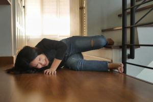 Asian woman suffering a slip and fall